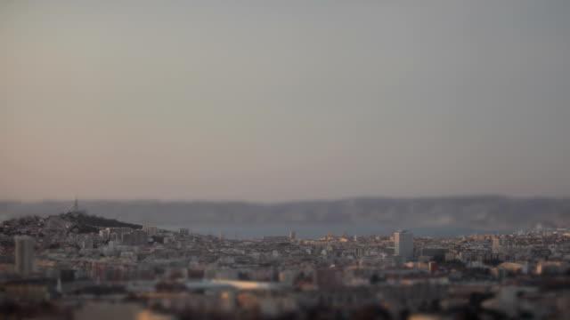 city timelapse tilt effect - hd - notre dame de la garde marseille stock videos and b-roll footage