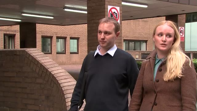 city trader in court accused of manipulating the libor system southwark crown court tom hayes photocall standing with his wife sarah outside... - 被告人点の映像素材/bロール