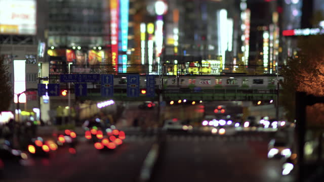 city traffic and neon lights in the evening (tilt-shift) - illuminated stock videos & royalty-free footage