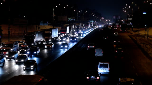 city traffic at night. rush hour in kiev. ukraine. - wet stock videos & royalty-free footage