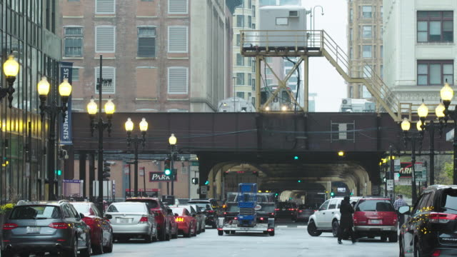 City traffic flow and Chicago elevated train against city scape, subway
