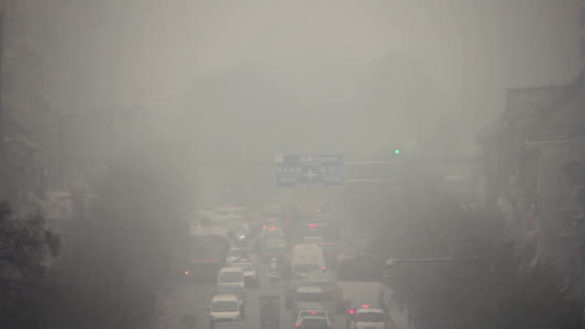 ms city traffic in thick fog / xi'an, shaanxi, china - pollution stock videos & royalty-free footage