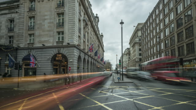 city traffic moving rapidly along piccadilly street passing the world famous ritz hotel - road signal stock videos & royalty-free footage