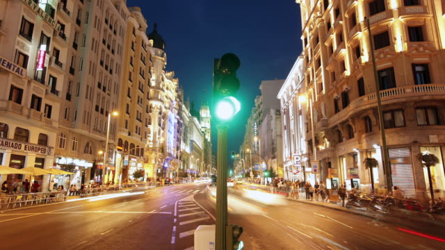 T/L City traffic obeying a changing traffic signal as dusk turns to night / Madrid, Spain on Gran Via at dusk / Madrid, Spain