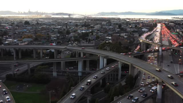 city traffic on freeway, wide aerial - oakland california stock videos & royalty-free footage