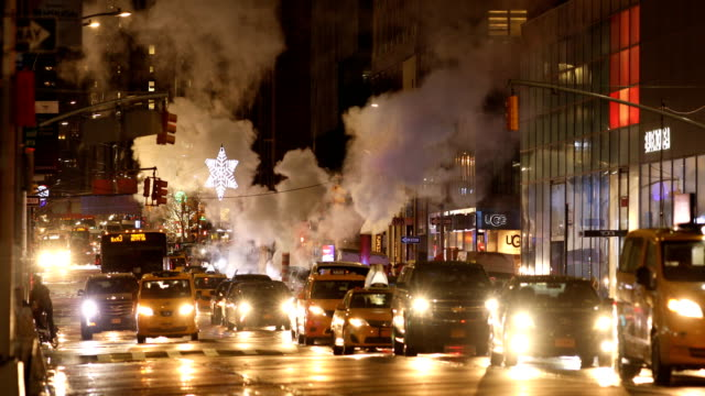city traffic on rainy night - avenue stock videos & royalty-free footage