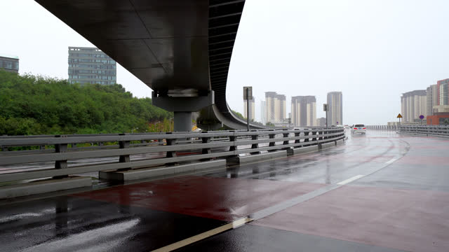 city traffic on the overpass in a rain. - abstract stock videos & royalty-free footage