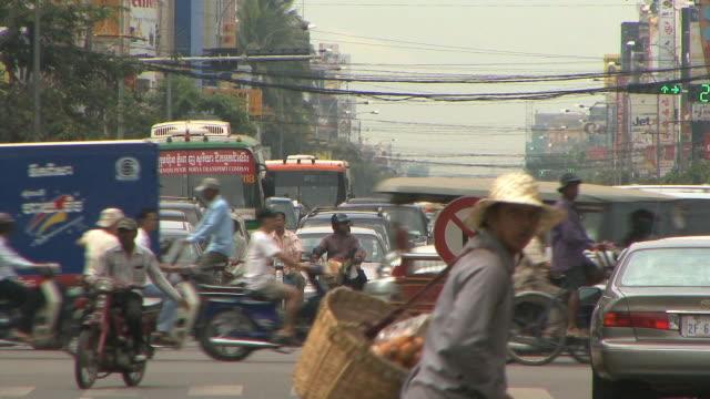 ls ms city traffic, phnom penh, cambodia - phnom penh stock videos and b-roll footage