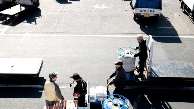 city traffic tokyo fish market - fish market stock videos & royalty-free footage