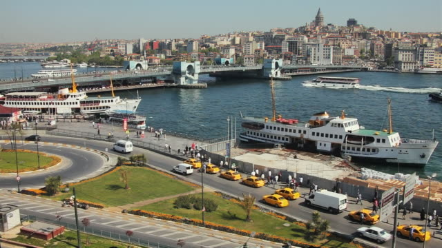 ws ha city traffic with galata bridge in background, istanbul, turkey - eminonu district stock videos and b-roll footage