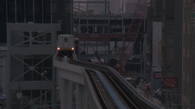 ms, cu, city train on monorail approaching to camera - monorail stock videos and b-roll footage