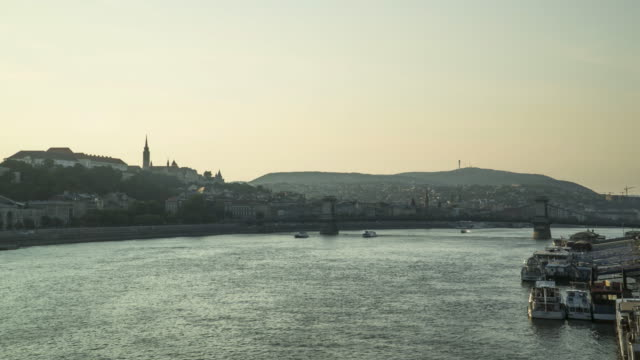 tl: city view around danube river that consisted of castle hill from elisabeth bridge on sunset in budapest, hungary - royal palace of buda stock videos & royalty-free footage