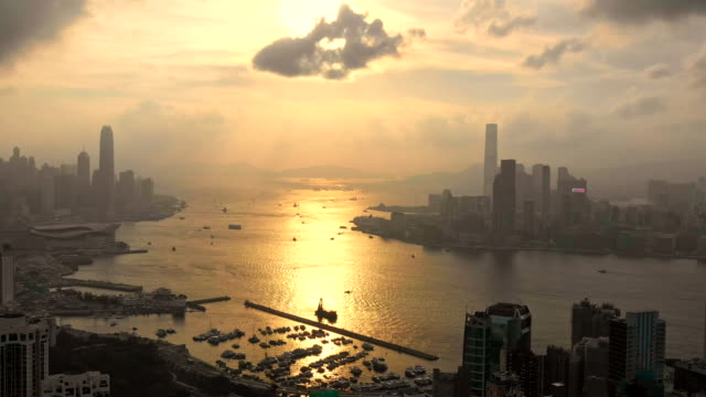 city view of high rise skyscraper buildings in hong kong - modern city skyline buildings of financial economy center - victoria harbour hong kong stock videos & royalty-free footage