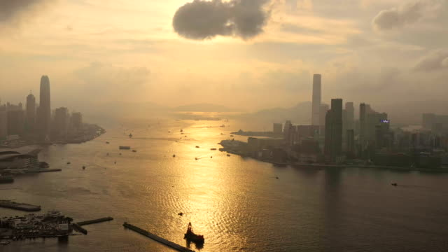 city view of high rise skyscraper buildings in hong kong - modern city skyline buildings of financial economy center - aircraft point of view stock videos & royalty-free footage