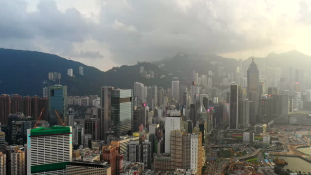 city view of high rise skyscraper buildings in hong kong - modern city skyline buildings of financial economy center - wan chai stock videos & royalty-free footage