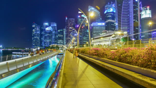 city view urban cityscape in singapore with people in scene - singapore flyer stock videos and b-roll footage