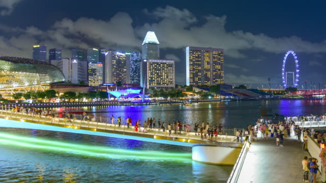 city view urban cityscape in singapore with people in scene - marina bay sands stock videos and b-roll footage