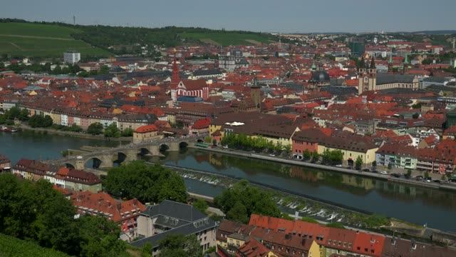 city with main river, old bridge, neumuenster collegiate church, town hall, st. kilians cathedral, wuerzburg, lower franconia, bavaria, germany - circa 11th century stock videos & royalty-free footage