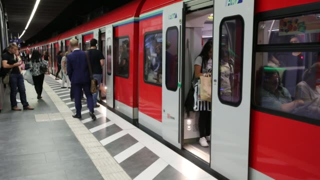 City workers alight from a train during the morning rush hour commute at Taunusanlage SBahn underground railway station in Frankfurt Germany on...
