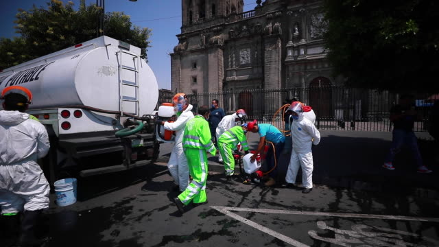 city workers disinfect the zocalo of mexico city and reforma avenue amid the covid-19 pandemic on april 6, 2020 in mexico city, mexico. health... - zocalo mexico city stock videos & royalty-free footage