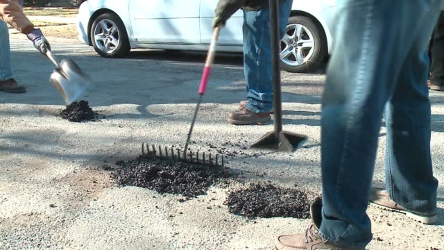 WGN City Workers FillingIn Repairing Potholes in Chicago on Feb 3 2017