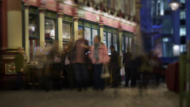 City workers meet and socialise after work outside a traditional English pub