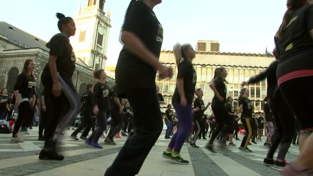 city workers take part in 'national fitness day' workout england london guildhall yard ext dame darcey bussell and colin jackson leading exercise... - darcey bussell bildbanksvideor och videomaterial från bakom kulisserna