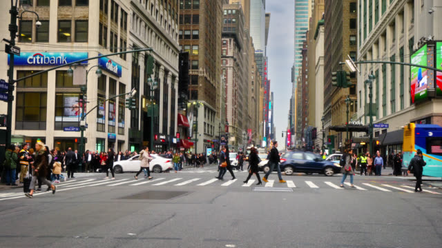 citybank and macy's clothing store at west 34th street. view of timesquare in background. people rush to get to places. new york, us - manhattan financial district stock videos & royalty-free footage