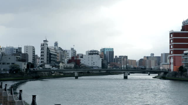 cityscape along the naka river in fukuoka, japan - fukuoka prefecture stock videos & royalty-free footage