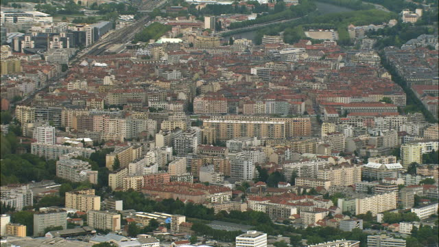 aerial ws cityscape and city center with isere river in background / grenoble, france - grenoble stock-videos und b-roll-filmmaterial