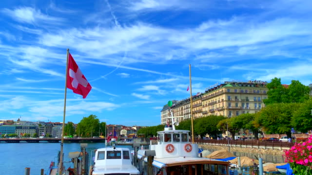 cityscape and lake geneva and luxury hotel - switzerland stock-videos und b-roll-filmmaterial