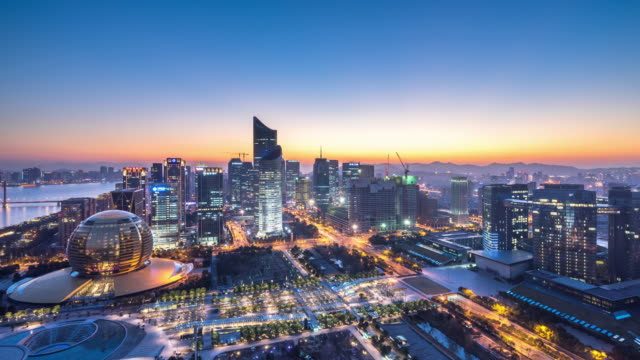 cityscape and skyline of hangzhou at sunset. timelapse 4k - hangzhou stock videos & royalty-free footage