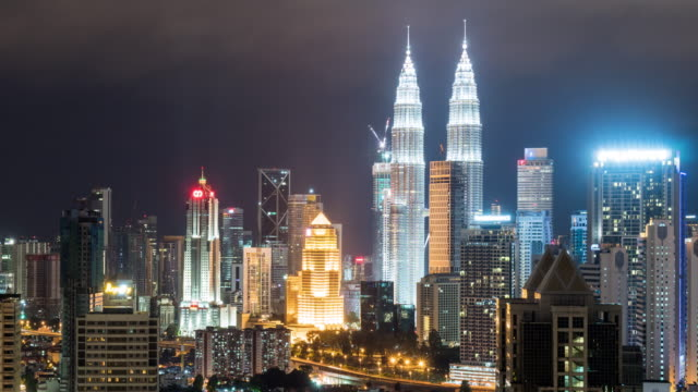 cityscape and skyline of kuala lumpur at night, time lapse 4k zoom out. - kuala lumpur stock videos & royalty-free footage