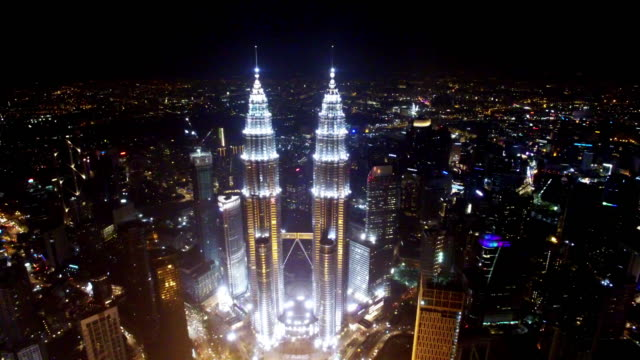 cityscape and skyline of kuala lumpur at night. - petronas twin towers stock videos & royalty-free footage