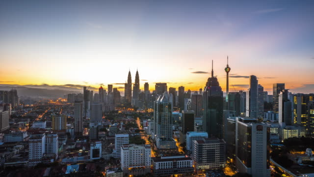 cityscape and skyline of kuala lumpur at sunrise. time lapse - malaysia stock videos and b-roll footage