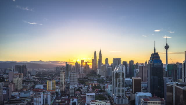 cityscape and skyline of kuala lumpur at sunrise. time lapse - dawn stock videos & royalty-free footage