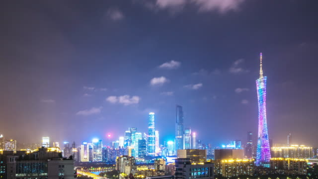 cityscape and skyline of new city near guangzhou tower at night. timelapse