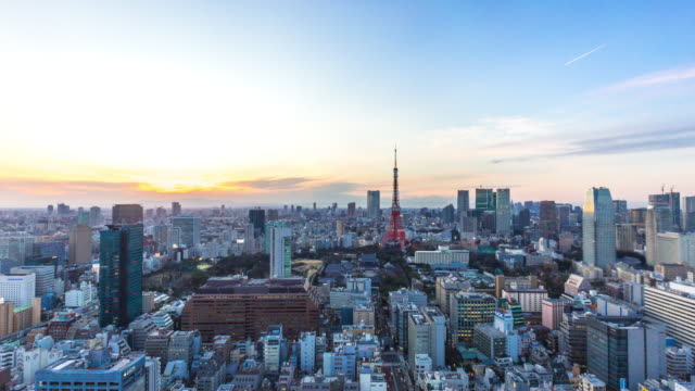 cityscape and skyline of tokyo at sunset. time lapse - tokyo japan stock videos & royalty-free footage