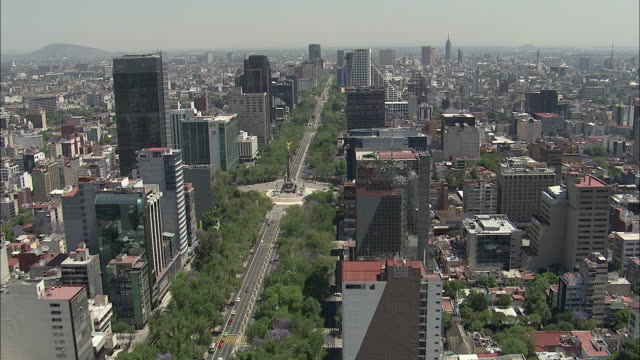 AERIAL, Cityscape and The Angel of Independence on roundabout over Paseo de la Reforma, Mexico City, Mexico