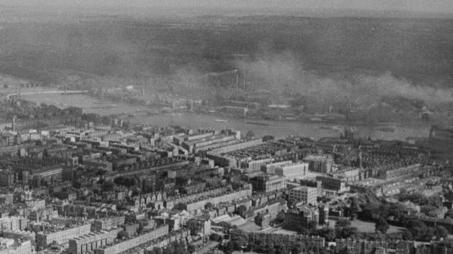 vídeos de stock, filmes e b-roll de 1948 aerial cityscape and water storage basins / london, england - 1948