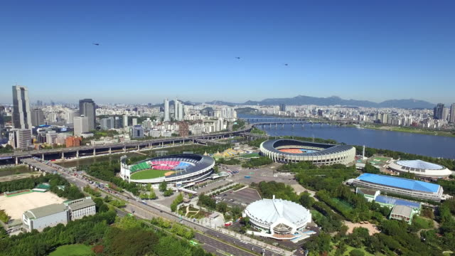 cityscape around jamsil sports complex and han river, seoul - personal land vehicle stock videos & royalty-free footage