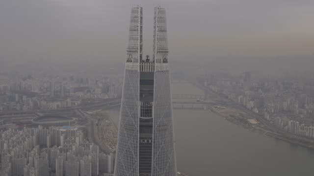 cityscape around lotte world tower, seoul, south korea - smog stock videos & royalty-free footage