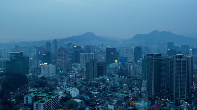ws t/l pan cityscape at evening to night / seoul, south korea - mid distance stock videos & royalty-free footage