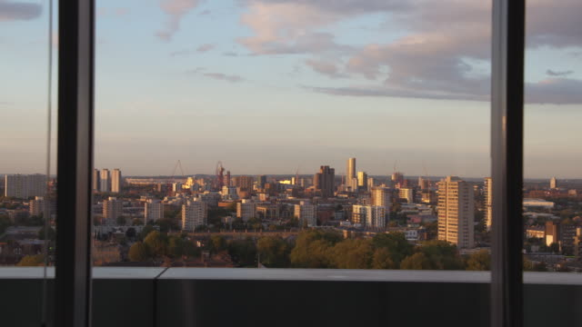 cityscape at golden hour through a window, london - england stock videos & royalty-free footage