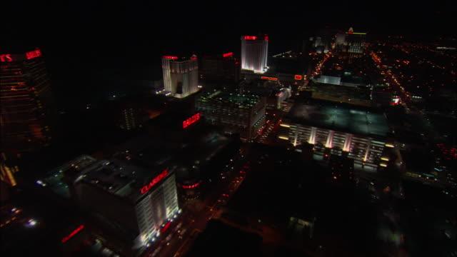 vídeos de stock, filmes e b-roll de aerial, cityscape at night, atlantic city, new jersey, usa - atlantic city