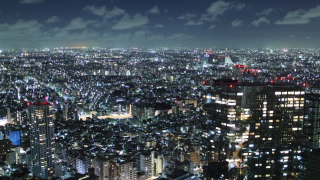 t/l ws ha zi cityscape at night / tokyo, japan - moving towards stock videos & royalty-free footage