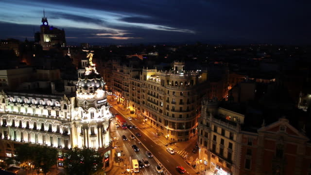 WS HA Cityscape at night with traffic on Gran Via and Metropolis Building / Madrid, Spain