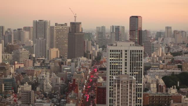ws ha cityscape at sunrise / tokyo, japan - 高層ビル点の映像素材/bロール