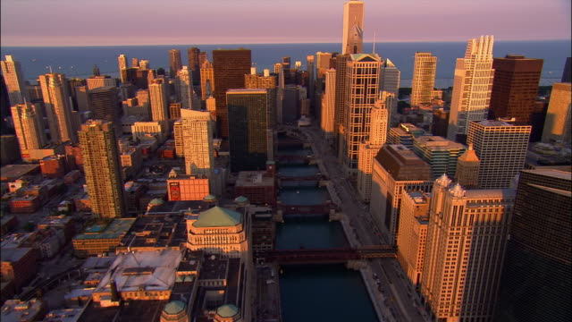 aerial, cityscape at sunset, chicago, illinois, usa - chicago river stock videos & royalty-free footage