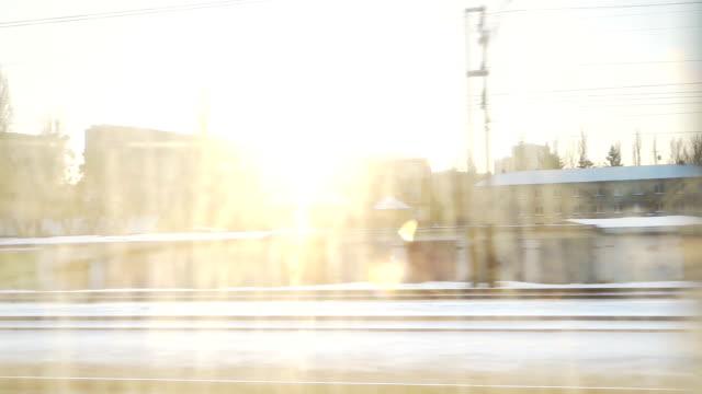 鉄道の窓から街並み - 線路のポイント点の映像素材/bロール